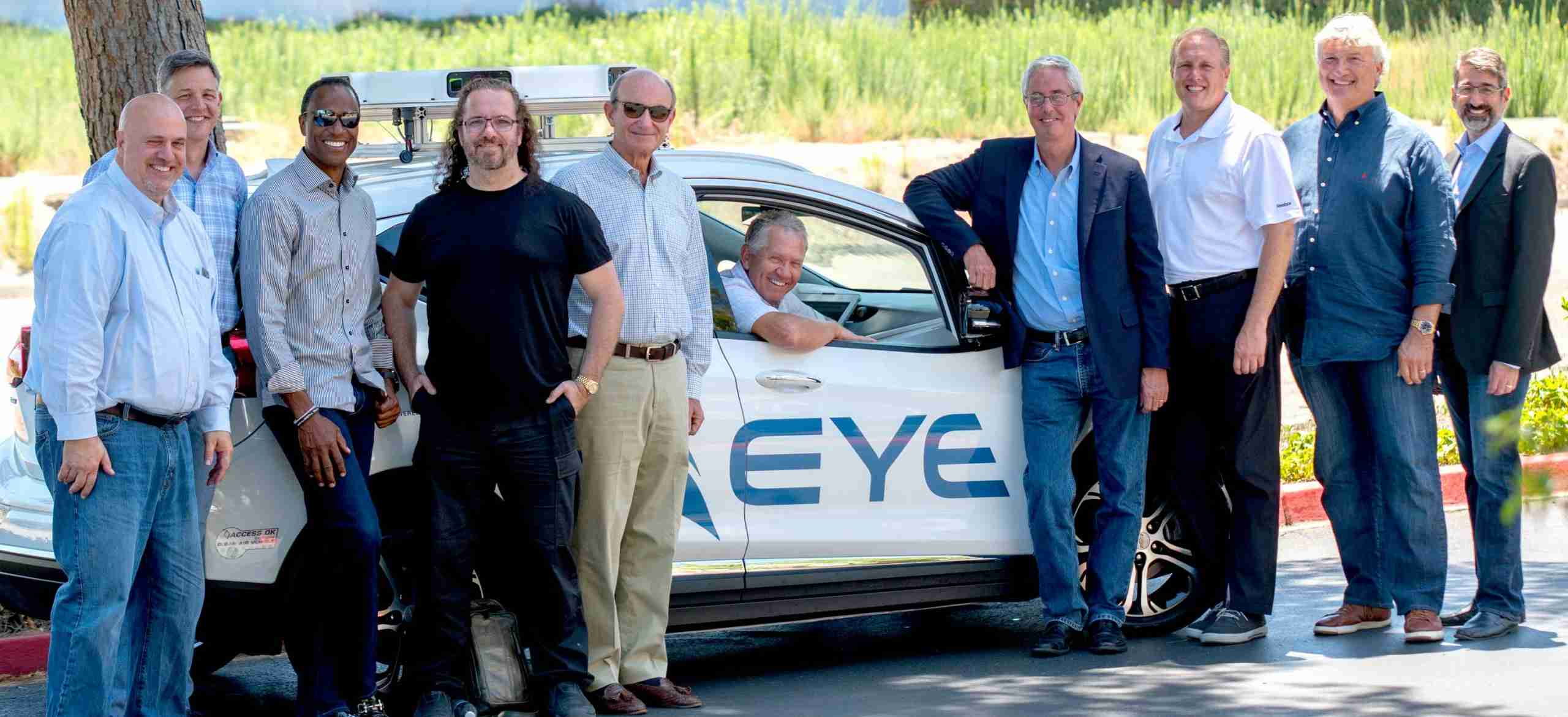 AEye Advisory Board posing in front of AEye's autonomous vehicle with AEye's iDAR smart sensor